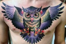 Awesome purple, red, green and yellow owl tattoo