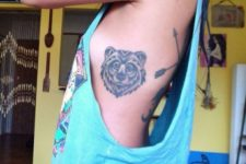 Bear head tattoo on the side