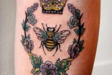 Bee with crown and flowers tattoo on the leg