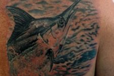 Big fish tattoo on the back