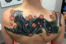 Big panther, flowers and hearts tattoo on the back
