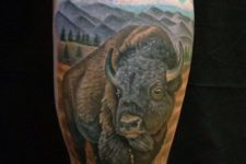 Bison and fields tattoo on the leg