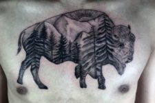 Bison with trees and mountains tattoo on the chest