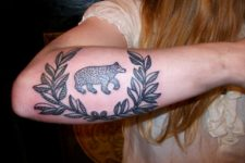 Black bear tattoo on the arm