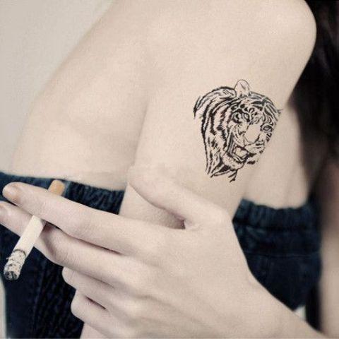 Black tiger tattoo on the arm