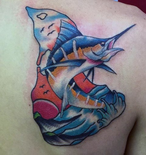 Blue and yellow fish tattoo on the back