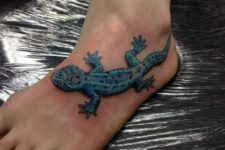 Blue lizard tattoo idea on the foot