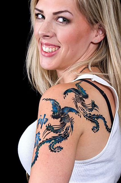 Blue phoenix tattoos on the shoulder