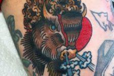 Cartoon bison tattoo on the hand
