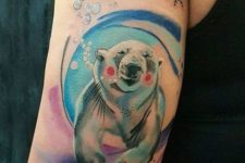 Cartoon polar bear tattoo on the arm