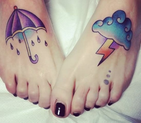 Cloud and umberlla tattoos on the feet