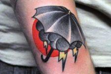 Cloud and umbrella tattoo on the forearm