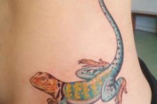 Colorful lizard tattoo on the side