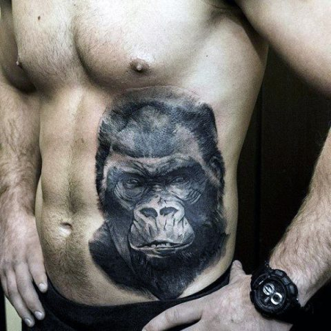 Cool gorilla face tattoo on the stomach