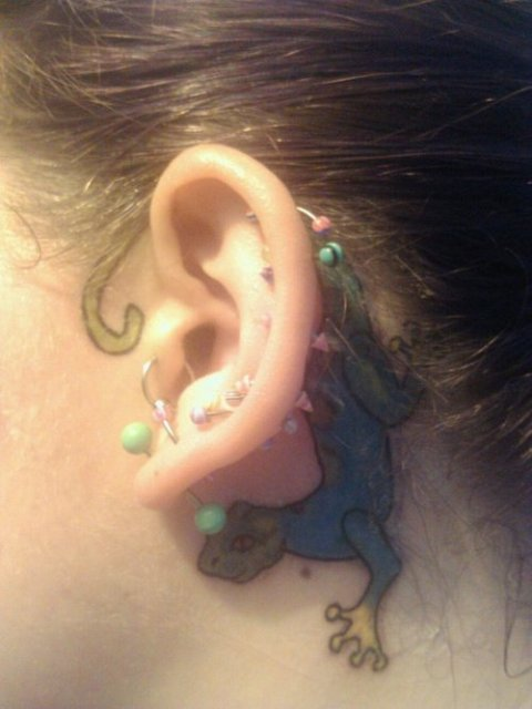 Cool tattoo behind the ear