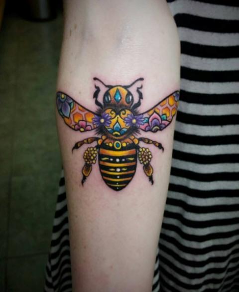 Creative bee tattoo on the hand