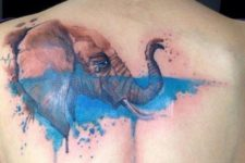 Crying elephant tattoo on the back