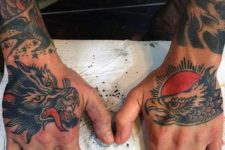 Eagle and red sun tattoo on the hand