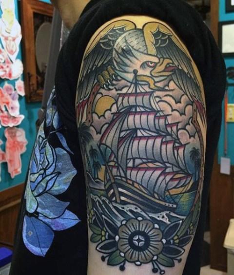 Eagle and ship tattoo on the arm