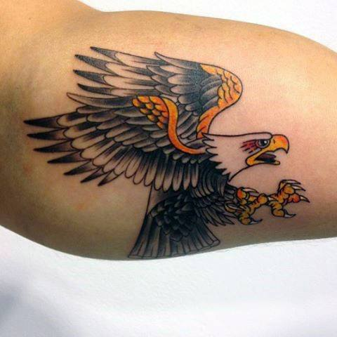 Eagle tattoo idea on the biceps