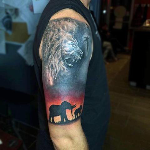 Elephant and lion tattoo on the hand