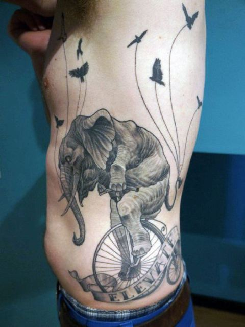 Elephant on wheels tattoo on the side