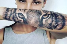 Eyes of the tiger tattoo on the forearm