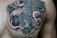 Flying eagle tattoo on the chest