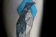 Geometric penguin tattoo on the leg