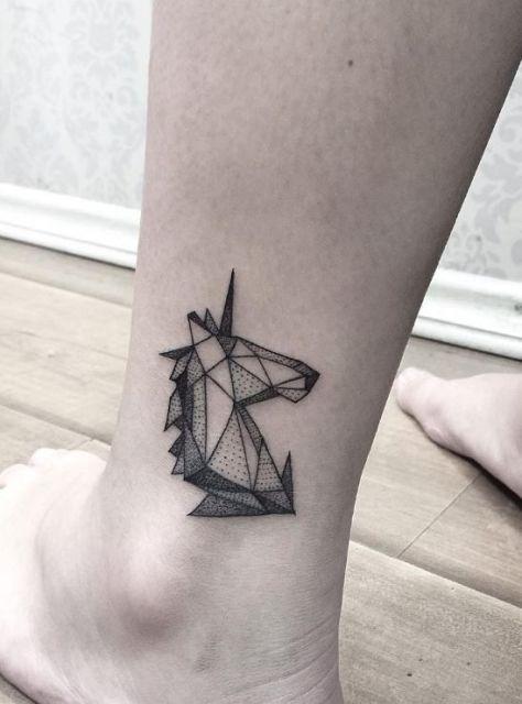 Geometric unicorn tattoo on the ankle