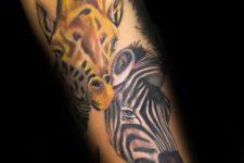 Giraffe and zebra tattoo on the hand