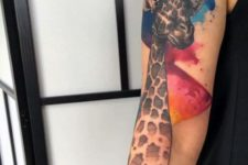Giraffe tattoo with red and blue splashes