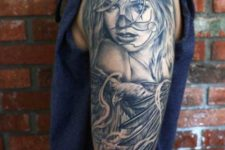Girl and eagle tattoo on the arm