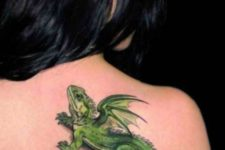 Gorgeous green lizard tattoo on the back
