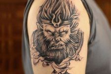 Gorgeous monkey king tattoo on the arm