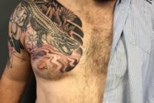 Gorgeous tattoo on the shoulder and chest