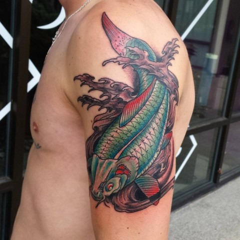 Green and red fish and waves tattoo