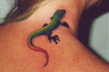 Green and red lizard tattoo on the neck and back