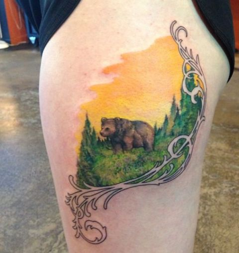 Grizzly bear tattoo on the thigh