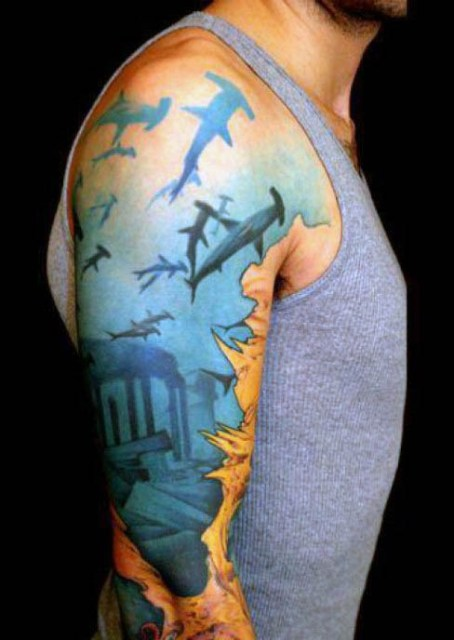 Half sleeve tattoo with several sharks