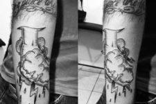 Hand grabbing clouds tattoo