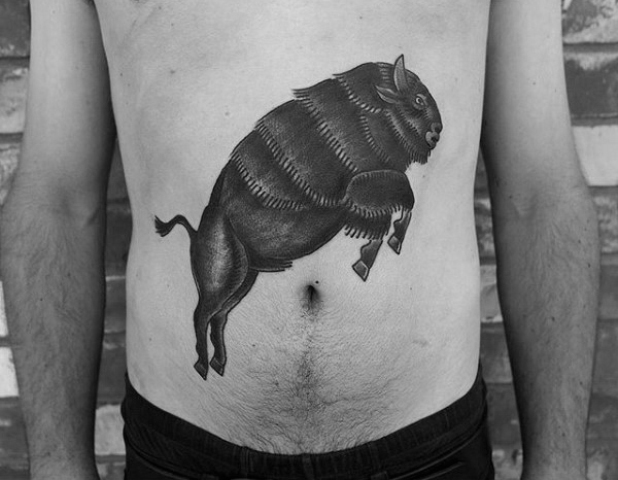 Jumping bison tattoo on the stomach