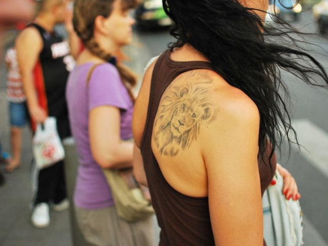 Lion head tattoo on the back