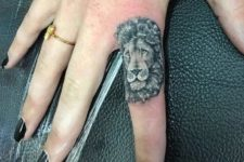 Lion tattoo on the finger