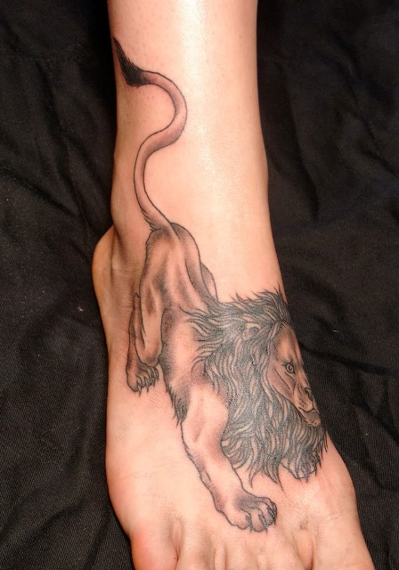 Lion tattoo on the foot