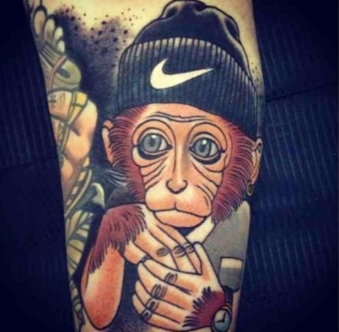 Monkey and hat tattoo