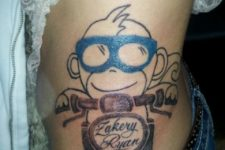 Monkey and motorcycle tattoo on the side