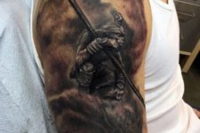 Monkey king tattoo on the arm