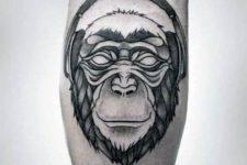Monkey with headphones tattoo on the leg