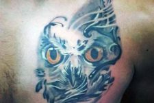 Owl face tattoo on the chest